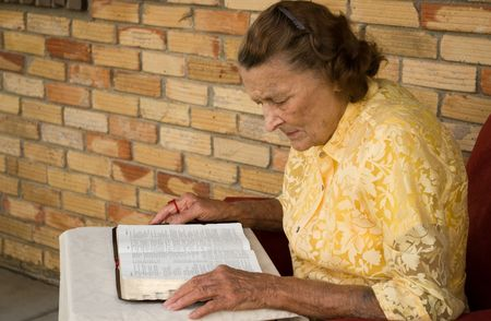 senior elderly caucasian female reading her Bible photo