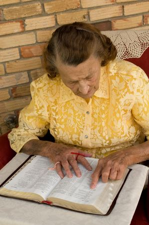 senior caucasian female reading the Bible photo