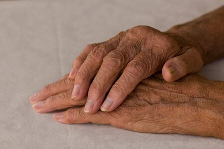 elderly hands folded over white background Stock Photo - 5994334