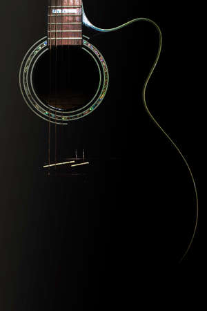 curves of a black body guitar lit