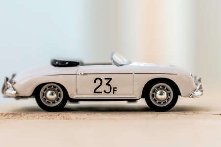 Miniature Porsche speedster cabrio on the road photo
