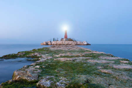 navigational light: stone path to the red lighthouse