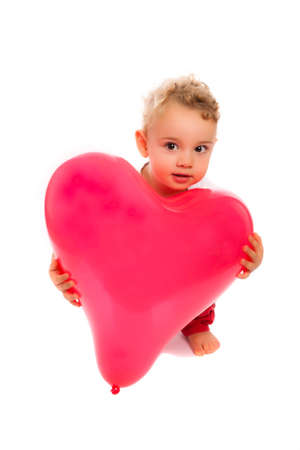 hearted: kid crouching with a red hearted balloon