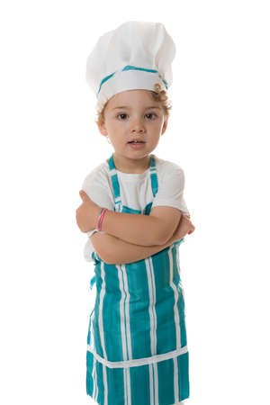 little chef with crossed arms standing on a isolated white background