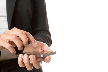 closeup of hands of business woman using a mobile phone - focus on the right hand photo