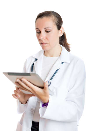 topicality: female doctor using a tablet standing isolated on a white background - focus on the face