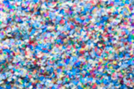 gaussian: unfocused confetti background consisting of small pieces of colored paper  - suitable as copy space