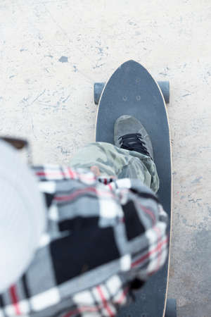subjective: subjective view of a foot of a skater on a skateboard - focus on the shoe