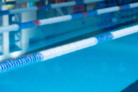 lane marker: unfocused closeup of lane marker buoys in a indoor swimming pool useful as a background Stock Photo