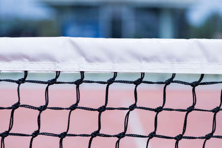 tennis net: detail of a part of the paddle tennis net - useful as a background - focus on the center of the image