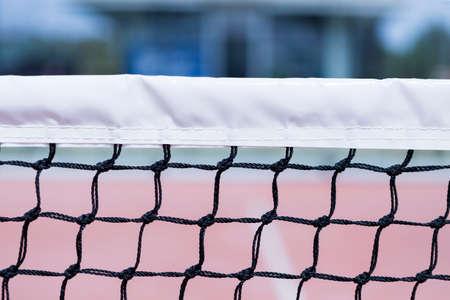 tenis: detalle de una parte de la red de tenis paddle - útil como fondo - se centran en el centro de la imagen Foto de archivo