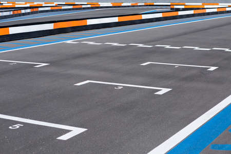 detail of the finish line in an outdoor go karting circuit useful as a background - focus on the number one