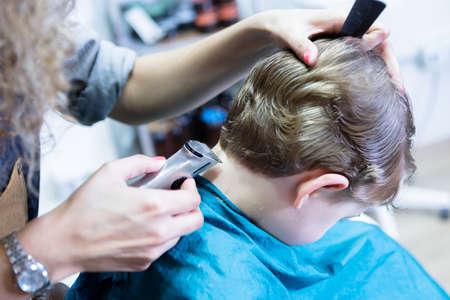 horizontal haircut: Hairdresser trimming boy neck. Unrecognizable Stock Photo