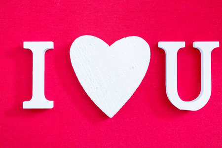 i love u: White I love U text on red background. Close-up