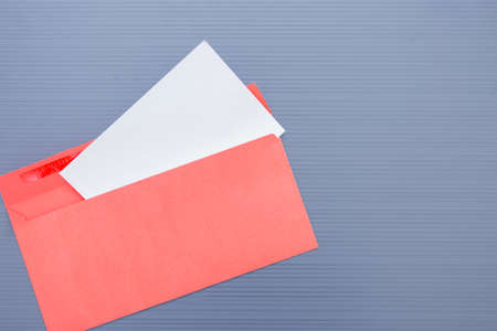 ribbed: Opened envelope with paper sheet on blue ribbed background.