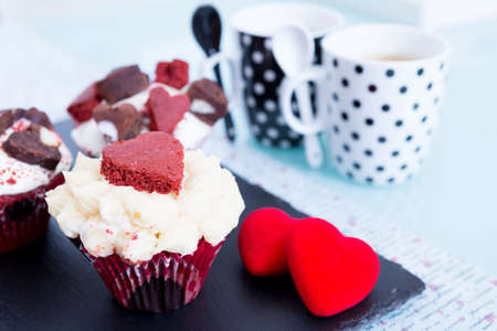saint valentines: Beautifully decorated cupcakes and cups of coffee on table. Saint Valentines Day. Stock Photo