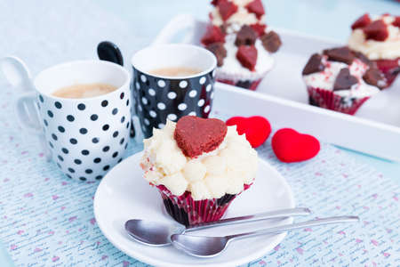 saint valentines: Decorated cupcake and two cups of coffee for Saint Valentines day.