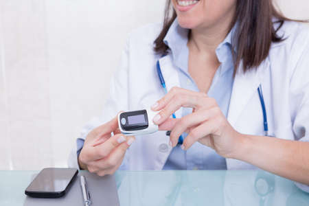 Woman hands holding medical device.