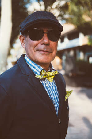 the distinguished: ALICANTE, SPAIN - SEPTEMBER 25, 2016: Close up of a middle aged man dressed in dapper styles is looking at the camera on the Distinguished Gentlemans Ride day, a global fundraiser for prostate cancer and mens health investigation Editorial