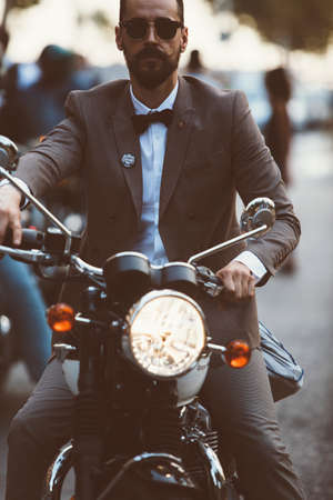 the distinguished: ALICANTE, SPAIN - SEPTEMBER 25, 2016: Portrait of a bearded young man is riding motorcycle on the Distinguished Gentlemans Ride day, a global fundraiser for prostate cancer and mens health investigation. Editorial