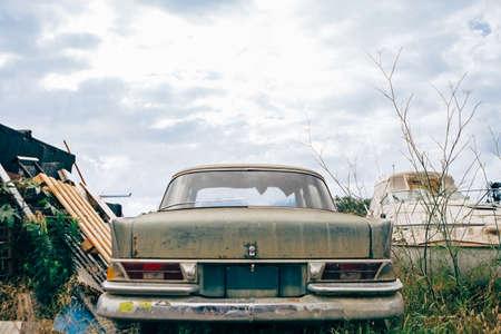 rusty car: View of classic rusty car bumper against of cloudy sky