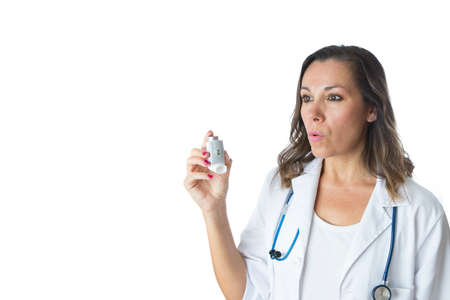 inhaled: Female doctor is exhaling the air before to use a pressurized cartridge inhaler - Isolated on a white background