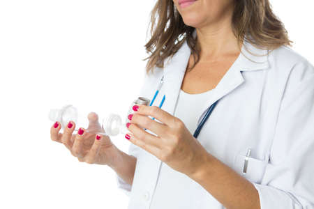 Female doctor is inserting a pressurized cartridge inhaler into an inhalation chamber on a medical demostration - Cropped view - Isolated on a white background