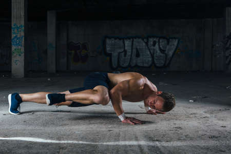 Sportsman while hard work out. Horizontal indoors shot Stock Photo