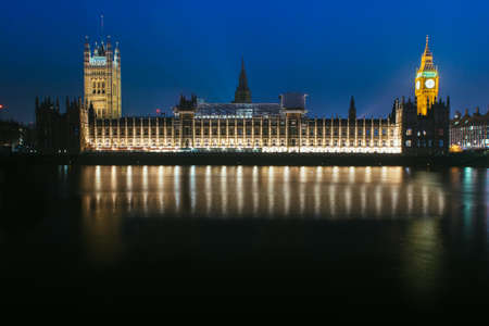 Panoramic view of the Houses of Parliament in London by night