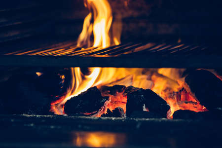 Close up of the detail of a barbecue grill on fire. Useful as a background