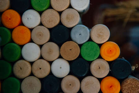 Heap of colored wine stoppers stacked in a wine cellar. Useful as a background