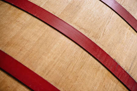 Detail of a wooden wine barrel. Useful as a background Imagens
