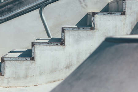 View of the detail of the stairs used as an obstacle of an empty urban skate park. Useful as a background.