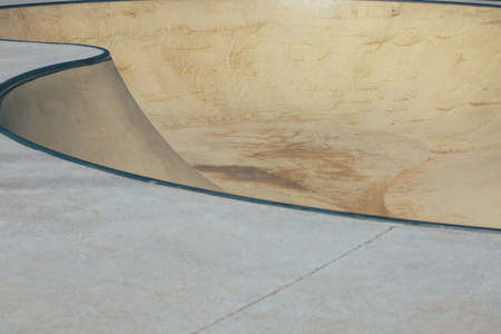 View of the detail of the bowls of an empty urban skate park. Useful as a background.
