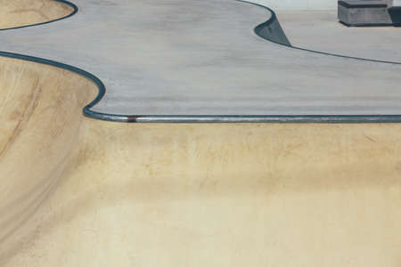 View of the detail of the ramps of an empty urban skate park. Useful as a background.