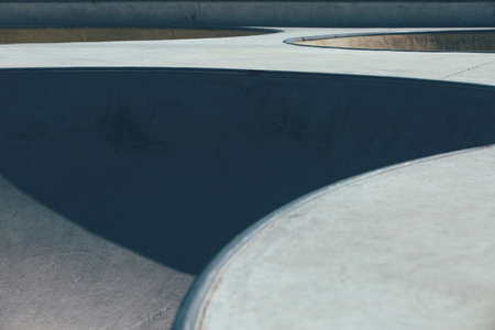 Detail of the ramps used as obstacles to make tricks in an empty urban skate park. Useful as a background.