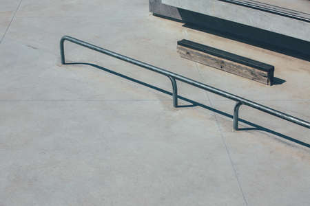 View of the obstacles to make tricks in an empty urban skate park as railings, stairs. Useful as a background.