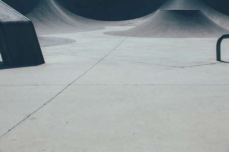 Detail of the view of a ramp used as obstacle to make tricks in an empty urban skate park. Useful as a background.