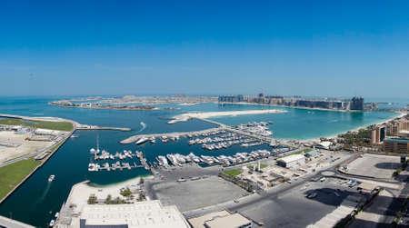 Marina and Yachts docked next to man made Islands