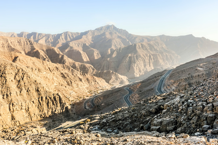 Geological landscape of Jabal Jais characterised by dry and rocky mountains, Mud Mountains in Ras Al Khaimah, United Arab Emirates Stock Photo
