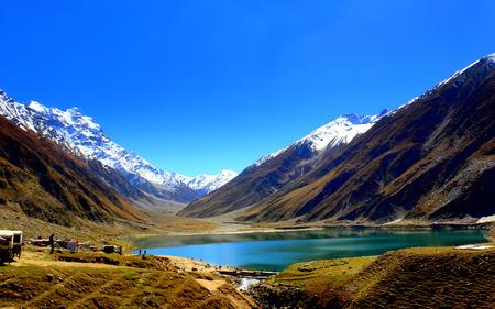 Beautiful view of mountainous lake Saiful Muluk in Naran Valley, Mansehra District, Khyber-Pakhtunkhwa, Northern Areas of Pakistan Stock Photo