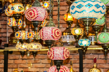 Traditional bright decorative hanging Turkish lights and colourful light lamps with vivid colours  in Turkey Pavilion, Global Village, Dubai, United Arab Emirates Stock Photo