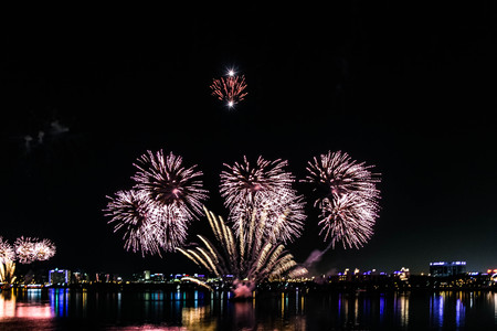 Explosion of multi-colored fireworks in Dubai against the night sky on a new year celebrations holidays