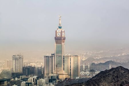 Scenic view of Makkah Tower, Clock Tower top view and dry mountains of holy city of Makkah, Saudi Arabia Stock Photo