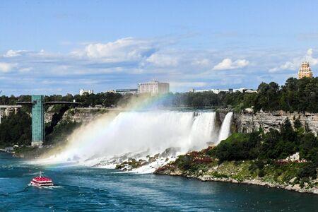 Niagara Falls American Falls on a summer day at the international border between Canada and the USA. Фото со стока