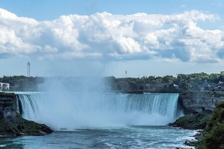Horseshoe Falls, also known as Canadian Falls on a summer day, is the largest of the three waterfalls that collectively form Niagara Falls on the Niagara River along the Canada–United States