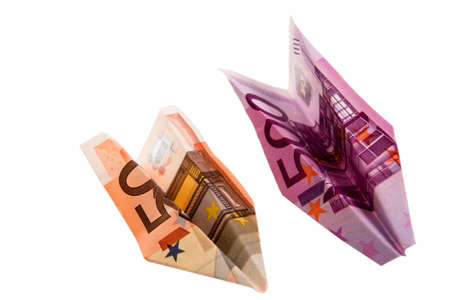 Paper planes from money advantage 50 and 500 on a white background Stock Photo - 12912904