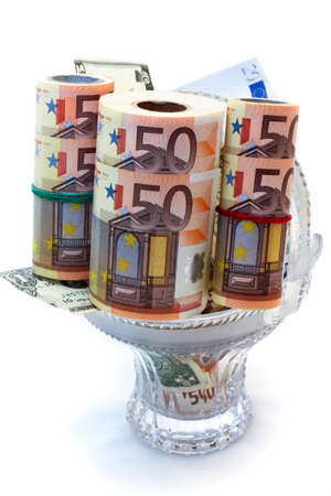 Monetary denominations laid in a vase on a white background photo