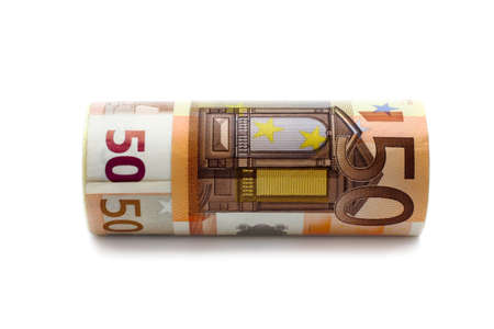 money worth 50 euros rolled on the white background