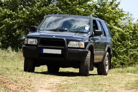 raod: off road 4X4 in country side on spring afternoon Stock Photo